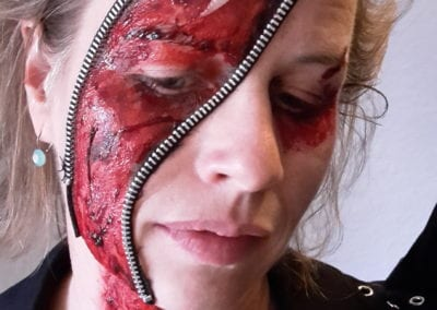 SFX Makeup, Reissverschluss im Gesicht Heidi Debbah Maskenbildnerin und SFX Artist